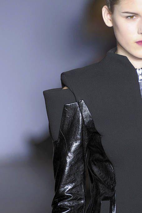 Ear, Hairstyle, Collar, Coat, Style, Formal wear, Fashion, Blazer, Leather, Black hair,