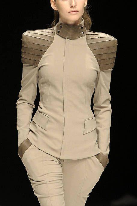 Sleeve, Joint, Collar, Fashion, Fashion model, Neck, Jewellery, Waist, Blazer, Beige,