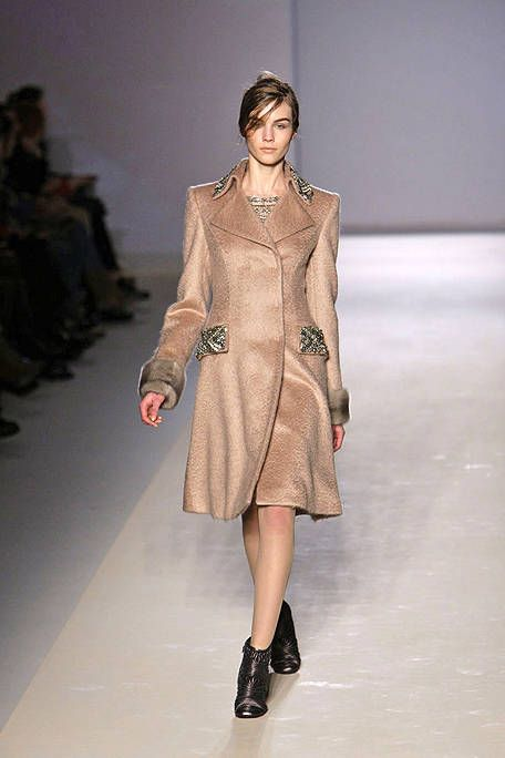 Clothing, Fashion show, Sleeve, Shoulder, Runway, Joint, Outerwear, Human leg, Style, Fashion model,
