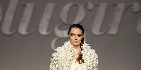 Clothing, Fashion show, Skin, Shoulder, Joint, Runway, Outerwear, Human leg, Fashion model, Style,