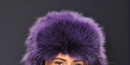 Human, Fur clothing, Textile, Purple, Natural material, Winter, Violet, Animal product, Headgear, Fashion,