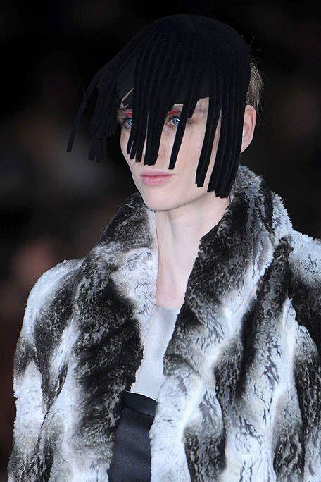 Lip, Hairstyle, Textile, Style, Black hair, Fur clothing, Bangs, Fashion, Black, Cool,