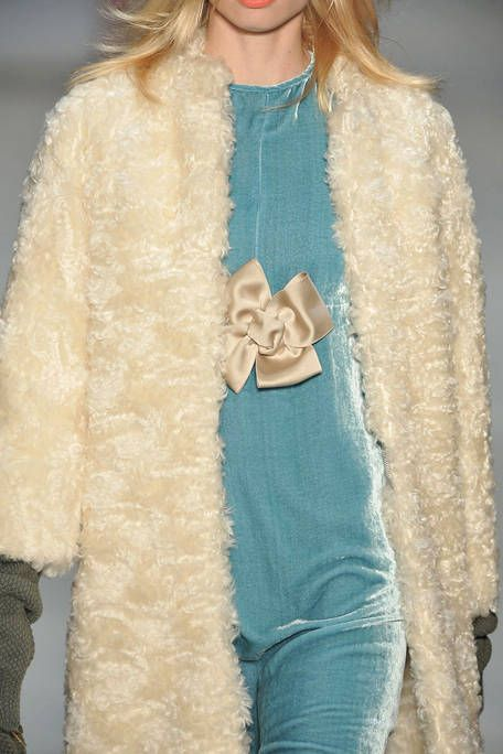 Textile, Outerwear, Fur clothing, Fashion, Natural material, Fashion model, Fur, Wrap, Animal product, Costume design,