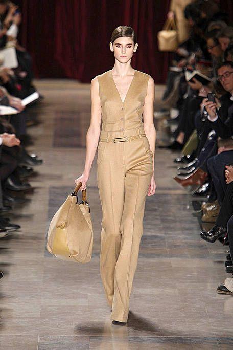 Brown, Fashion show, Shoulder, Outerwear, Runway, Fashion model, Style, Formal wear, Fashion, Waist,