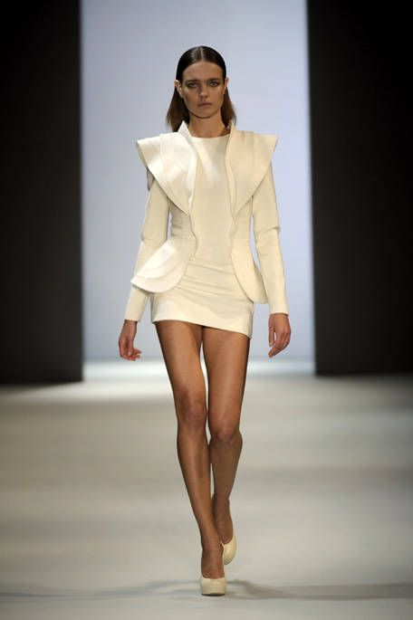 Clothing, Fashion show, Human body, Shoulder, Human leg, Runway, Joint, Outerwear, Style, Fashion model,
