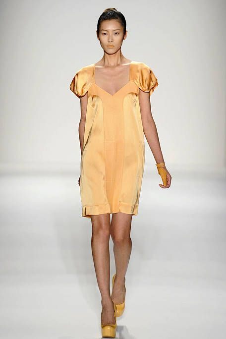 Clothing, Brown, Yellow, Sleeve, Shoulder, Human leg, Dress, Fashion show, Joint, One-piece garment,