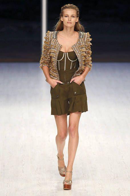 Clothing, Fashion show, Brown, Human body, Shoulder, Runway, Joint, Human leg, Fashion model, Style,