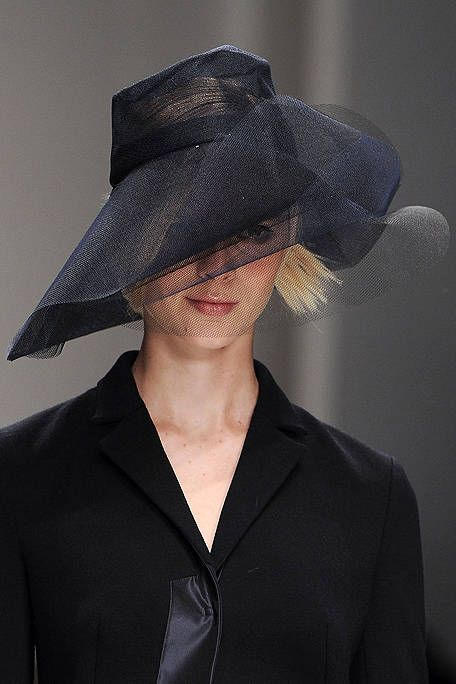 Clothing, Lip, Collar, Hat, Sleeve, Dress shirt, Formal wear, Coat, Headgear, Costume accessory,