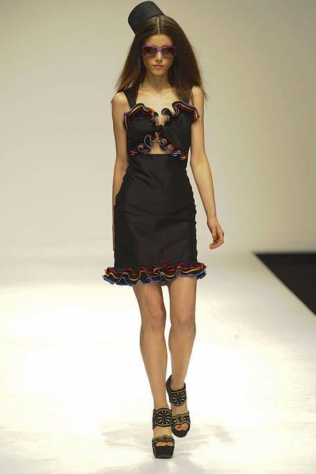 Clothing, Leg, Fashion show, Dress, Human leg, Human body, Shoulder, Joint, Fashion model, Hat,