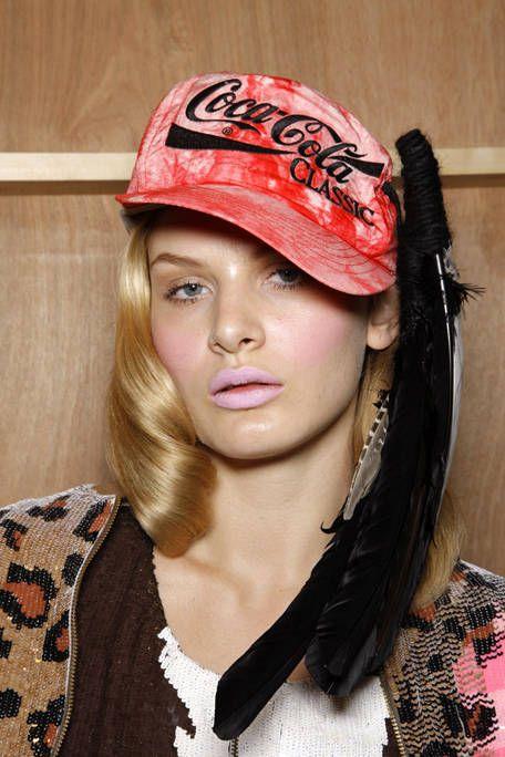 Lip, Hairstyle, Cap, Pattern, Style, Headgear, Fashion accessory, Fashion, Costume accessory, Street fashion,