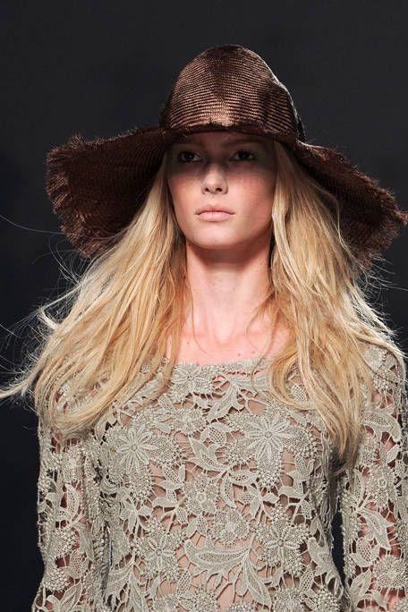 Clothing, Hat, Lip, Brown, Sleeve, Headgear, Costume accessory, Fashion, Sun hat, Street fashion,
