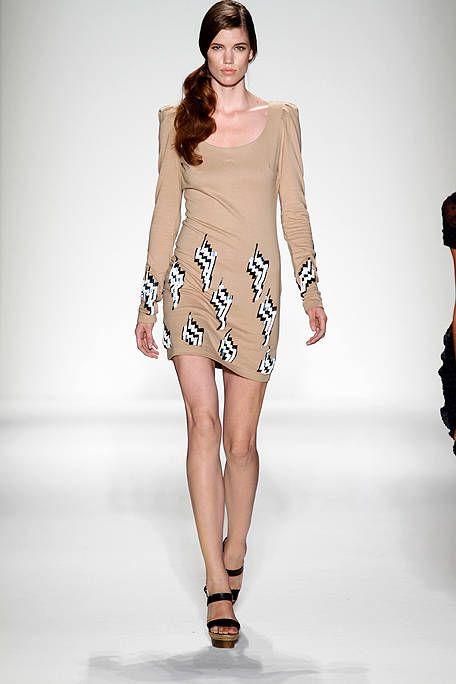 Brown, Skin, Fashion show, Human leg, Shoulder, Joint, Runway, Fashion model, Style, Waist,
