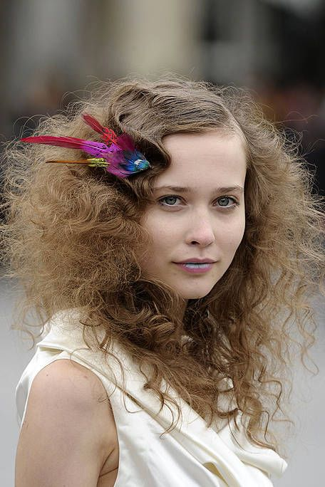 Hairstyle, Eyebrow, Style, Eyelash, Beauty, Hair accessory, Sleeveless shirt, Headpiece, Ringlet, Long hair,