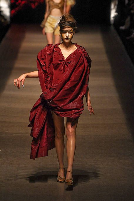 Fashion, Sandal, Fashion model, Fashion show, Model, High heels, Costume design, Fashion design, Silk, Foot,