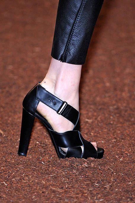 Footwear, Human leg, Joint, High heels, Sandal, Fashion, Black, Leather, Tan, Close-up,