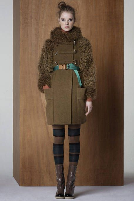 Leg, Brown, Sleeve, Human body, Textile, Standing, Joint, Outerwear, Riding boot, Style,