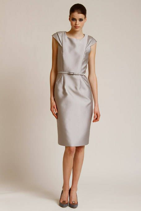 Sleeve, Shoulder, Dress, Human leg, Joint, Standing, White, One-piece garment, Style, Formal wear,