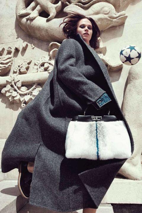 Style, Bag, Street fashion, Art, Ball, Fur, Shoulder bag, Soccer ball, Long hair, Football,