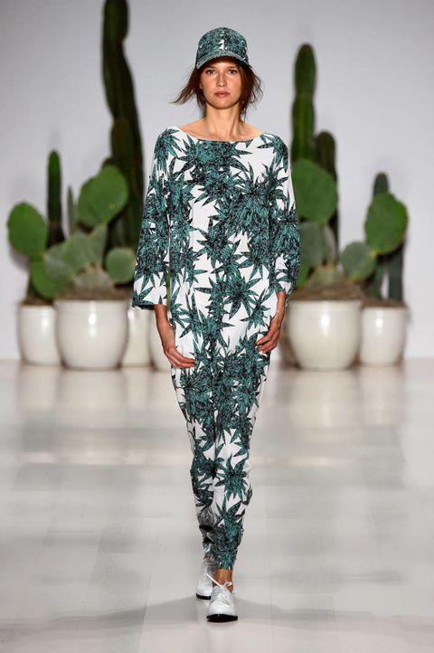 Green, Shoulder, Flowerpot, Style, Fashion show, Hat, Waist, Runway, Fashion, Fashion model,