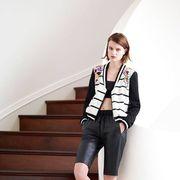 Clothing, Footwear, Leg, Brown, Sleeve, Human leg, Shoulder, Collar, Shoe, Stairs,