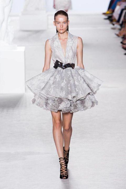 Fashion show, Dress, Shoulder, Joint, White, Runway, Style, Fashion model, One-piece garment, Fashion accessory,