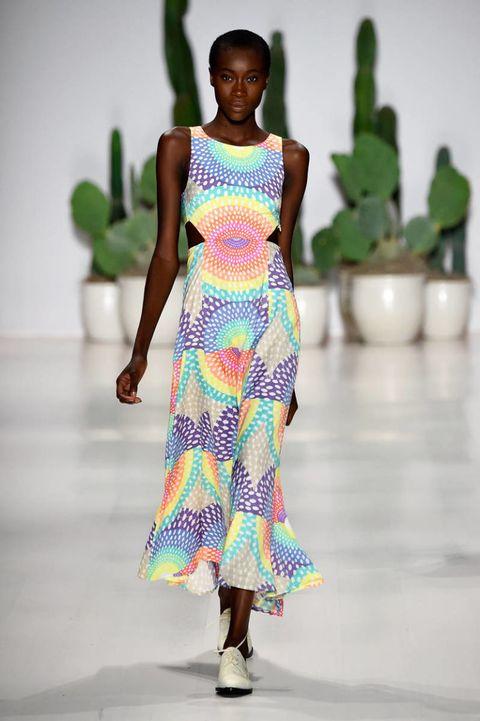 Green, Fashion show, Shoulder, Joint, One-piece garment, Style, Runway, Dress, Fashion model, Flowerpot,