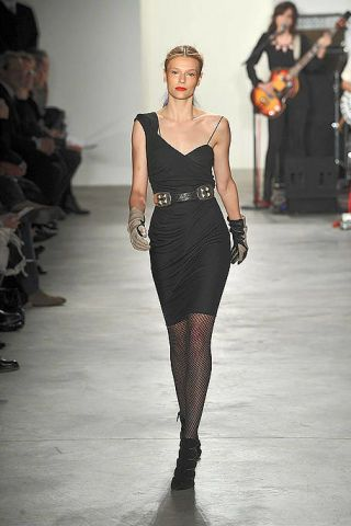 Fashion show, Human body, Musical instrument, Shoulder, Musician, Runway, Joint, Guitar, Fashion model, Style,