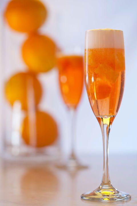 Glass, Yellow, Stemware, Wine glass, Orange, Drinkware, Drink, Barware, Liquid, Tableware,