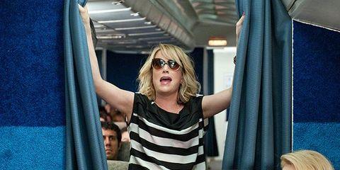 Shoulder, Textile, Interior design, Blond, Comfort, Sunglasses, Curtain, Passenger, Public transport, Linens,