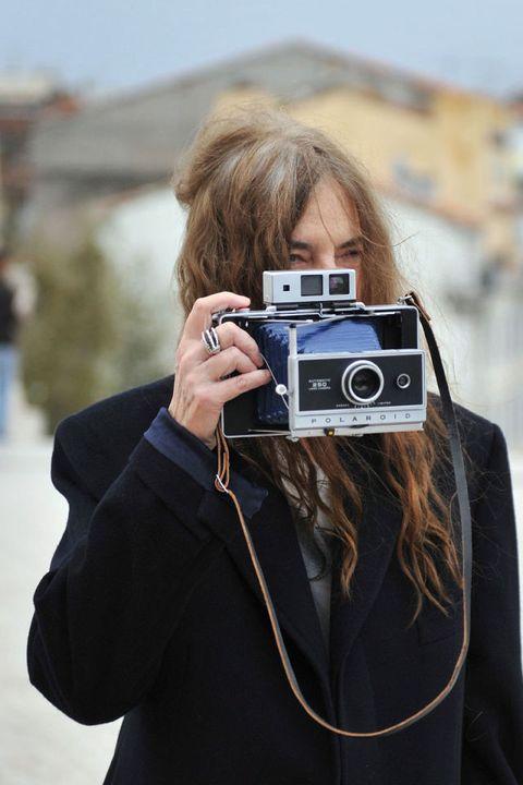 Sleeve, Lens, Digital camera, Photographer, Camera, Photograph, Outerwear, Cameras & optics, Single-lens reflex camera, Point-and-shoot camera,