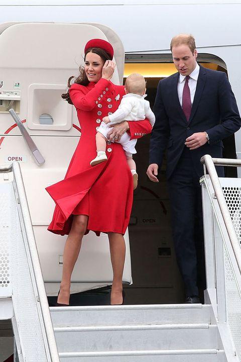 Leg, Dress, Standing, Coat, Red, Formal wear, Suit, One-piece garment, Tie, Handrail,