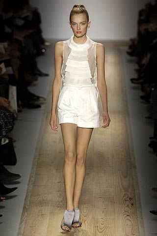 Clothing, Leg, Brown, Human leg, Shoulder, Fashion show, Textile, Joint, White, Style,