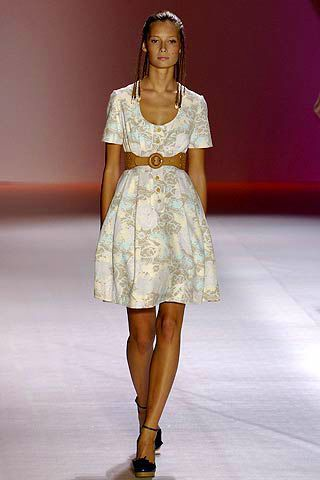 Clothing, Brown, Human leg, Shoulder, Dress, Fashion show, Joint, Jewellery, Style, Fashion model,