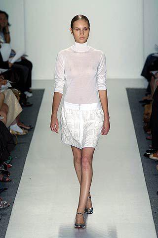 Clothing, Footwear, Leg, Fashion show, Sleeve, Human leg, Shoulder, Textile, Joint, Runway,
