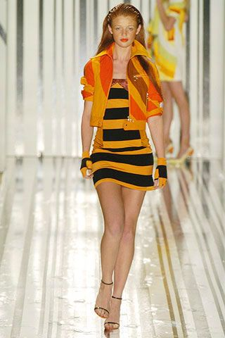Leg, Yellow, Dress, Human leg, Shoulder, Fashion show, Joint, One-piece garment, Fashion model, Style,