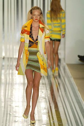 Clothing, Leg, Fashion show, Yellow, Human body, Shoulder, Human leg, Runway, Outerwear, Fashion model,