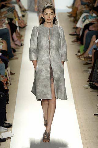 Footwear, Leg, Fashion show, Shoulder, Runway, Human leg, Joint, Fashion model, Style, Dress,