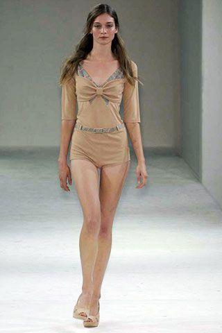 Skin, Fashion show, Human body, Human leg, Shoulder, Joint, Runway, Waist, Fashion model, Style,