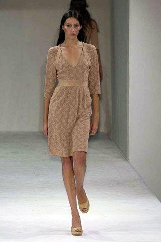 Clothing, Brown, Human body, Fashion show, Human leg, Shoulder, Joint, Dress, Style, Runway,