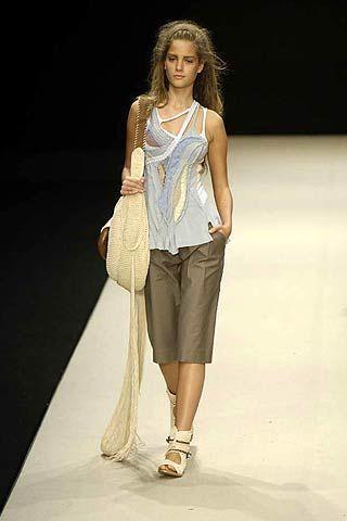 Clothing, Brown, Human body, Fashion show, Shoulder, Human leg, Joint, White, Style, Fashion model,