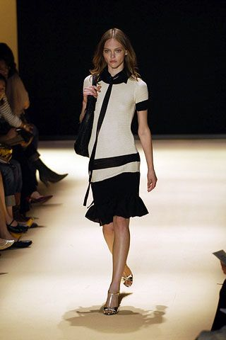 Footwear, Leg, Fashion show, Human leg, Shoulder, Joint, Runway, Guitar, Fashion model, Style,