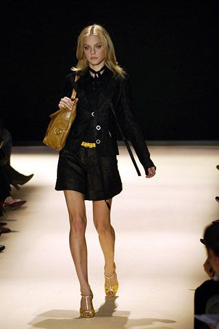 Clothing, Event, Human leg, Fashion show, Shoulder, Joint, Outerwear, Runway, Fashion model, Style,