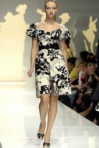 Clothing, Fashion show, Shoulder, Human leg, Joint, Fashion model, Dress, Runway, Style, One-piece garment,