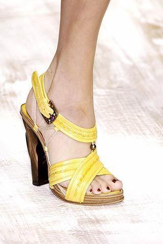 Footwear, Yellow, Toe, High heels, Human leg, Sandal, Joint, Shoe, Style, Foot,