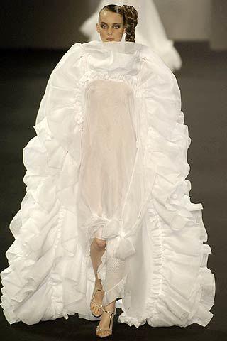 Textile, Formal wear, Bridal clothing, Gown, Costume design, Dress, Wedding dress, Fashion, Fashion model, Veil,