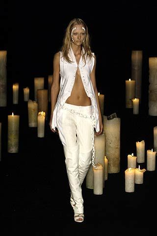 Beauty, Candle, Candle holder, Blond, Fashion model, Long hair, Wax, Fashion design, Flame, Model,