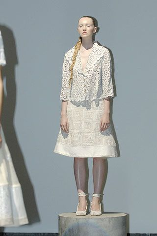 Sleeve, Dress, Textile, Standing, Joint, One-piece garment, Pattern, Fashion, Neck, Knee,