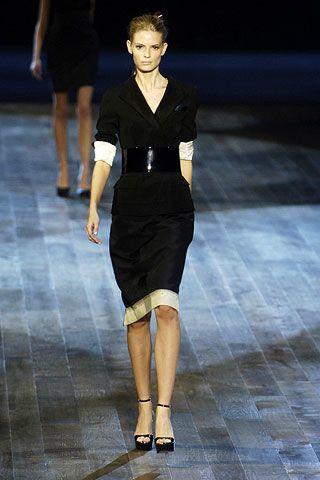 Clothing, Leg, Human body, Shoulder, Fashion show, Human leg, Dress, Joint, Runway, Formal wear,