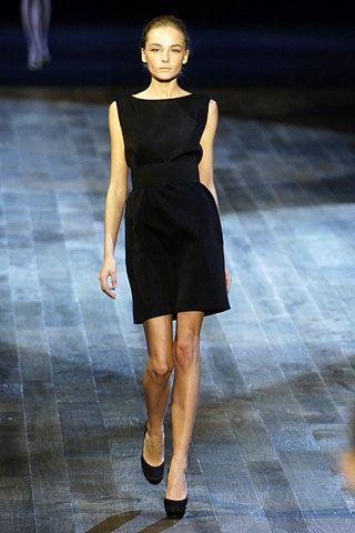 Clothing, Dress, Human body, Shoulder, Human leg, Fashion show, Joint, One-piece garment, Style, Formal wear,