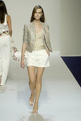 Clothing, Leg, Brown, Sleeve, Human leg, Shoulder, Fashion show, Textile, Joint, White,